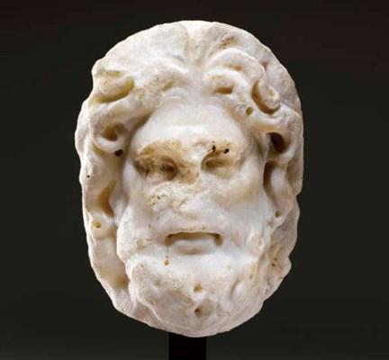 A ROMAN MARBLE HEAD OF JUPITER