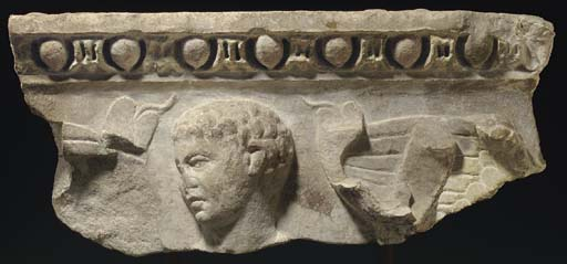 A ROMAN MARBLE RELIEF FRAGMENT