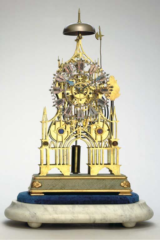 A Victorian Brass Gothic Frame Striking Skeleton Clock
