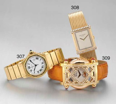 CARTIER. AN 18K GOLD OCTAGONAL