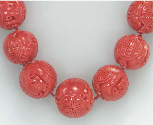 **A CARVED CORAL BEAD NECKLACE
