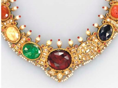 **A MULTI-GEM, GOLD AND ENAMEL