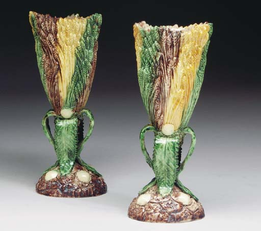 A PAIR OF MAJOLICA VASES,