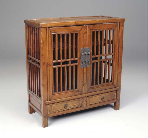 AN ASIAN WOOD CABINET,