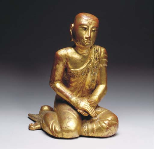 A GILT LACQUERED WOOD FIGURE O
