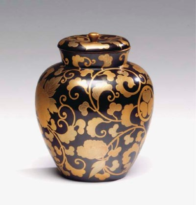A JAPANESE LACQUER TEA JAR AND