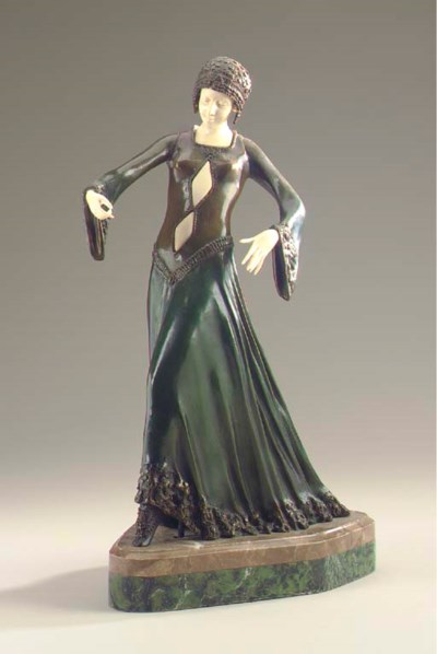 AN IVORY AND PATINATED BRONZE