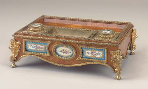 A LOUIS XV STYLE GILT-METAL AN