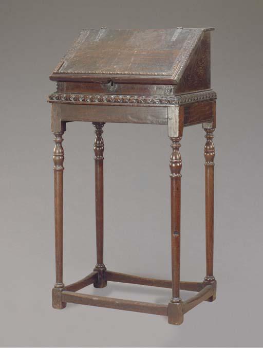 A JACOBEAN OAK WRITING BOX ON