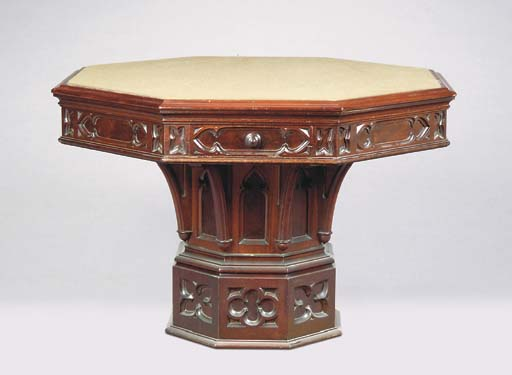 A GOTHIC REVIVAL CARVED WALNUT