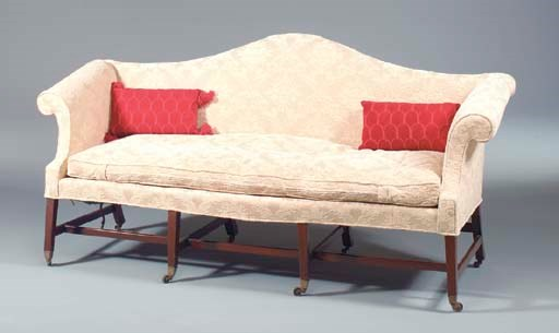 A CHIPPENDALE SOFA ON CASTERS