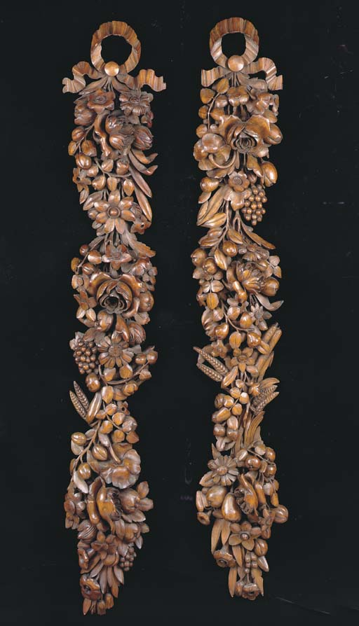 A PAIR OF CARVED AND STAINED L
