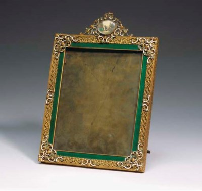 A GILT METAL AND ENAMEL PICTUR