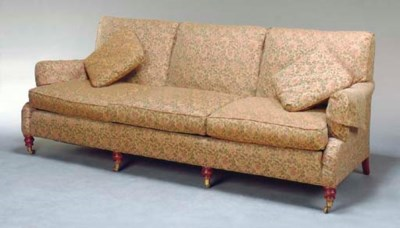 A CONTEMPORARY SOFA COVERED IN
