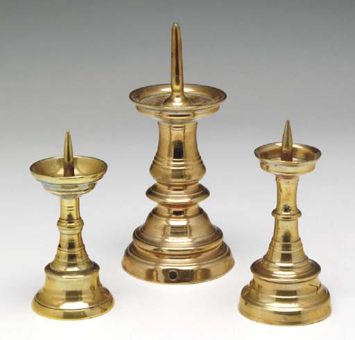 A GROUP OF THREE BRASS PRICKET