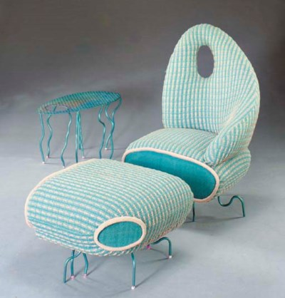 A CONTEMPORARY UPHOLSTERED AND