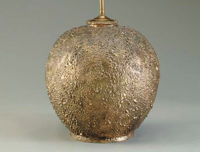 A BRONZE-PAINTED TEXTURED COMP