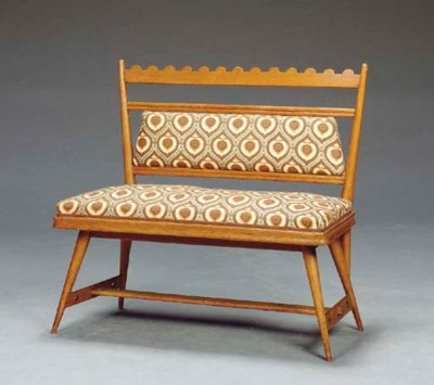 AN OAK AND UPHOLSTERED BENCH,