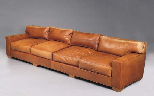 A CONTEMPORARY BROWN LEATHER U