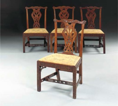 A SET OF FOUR MAHOGANY DINING-