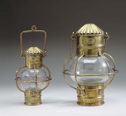 Two brass and glass globe lant