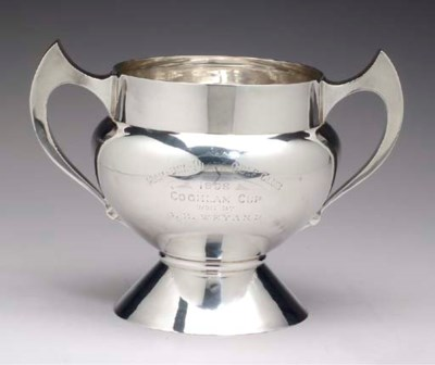 A GEORGE V SILVER TROPHY,
