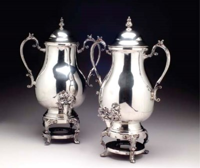 A PAIR OF SILVER-PLATED HOT WA