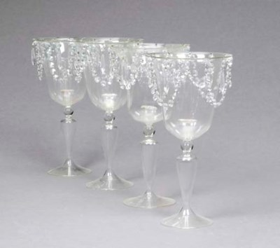 A SET OF FOUR MOULDED AND CUT-