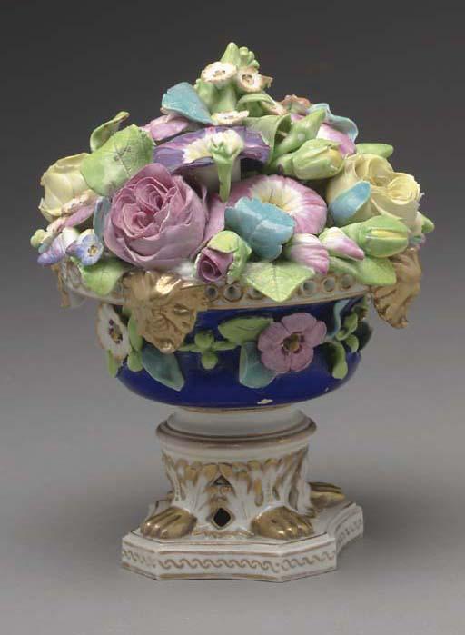 A DERBY PORCELAIN FLOWER-ENCRU