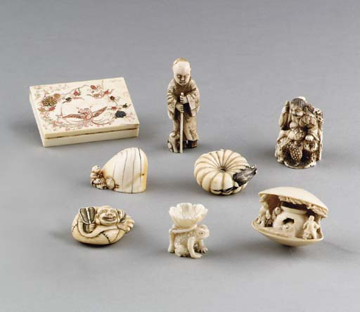 A GROUP OF JAPANESE CARVED IVO
