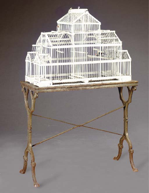A WHITE PAINTED BIRDCAGE ON A