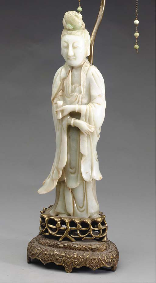 A CARVED JADEITE FIGURE OF GUA