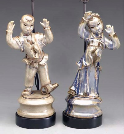 A PAIR OF EARTHENWARE FIGURES