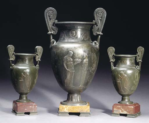 A GROUP OF THREE PATINATED URN