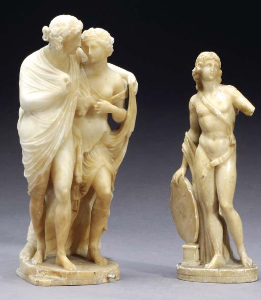 AN ALABASTER FIGURE OF CUPID A