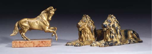 A PAIR OF CAST-IRON AND GILT F