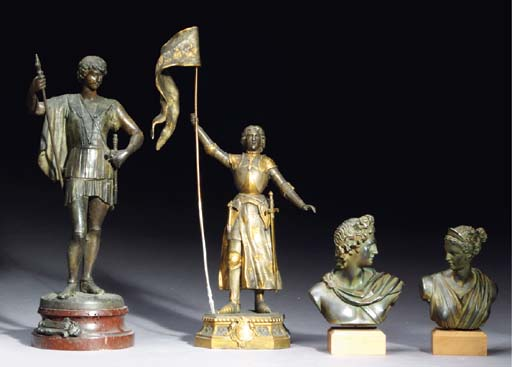 A GROUP OF FOUR PATINATED-META