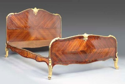 A LOUIS XV STYLE MAHOGANY AND