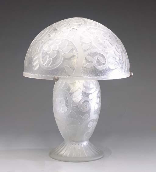 AN ART DECO STYLE GLASS TABLE