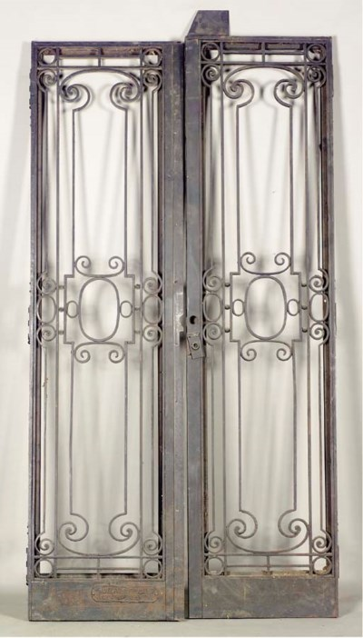 A PAIR OF WROUGHT IRON GATES,
