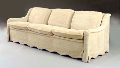 A SOFA UPHOLSTERED IN EMBOSSED