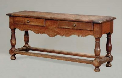 A CONTINENTAL OAK LOW TABLE WI