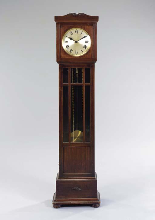 A MAHOGANY TALL CASE CLOCK,