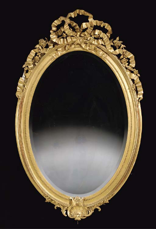 A VICTORIAN OVAL GILT WALL MIR