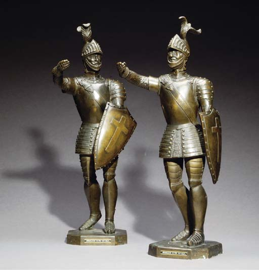 A SET OF TWO PATINATED BRONZE