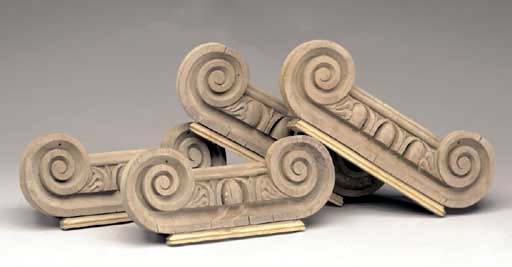 A SET OF FOUR CARVED PINE WOOD
