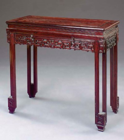 A CHINESE CARVED HARDWOOD CONS
