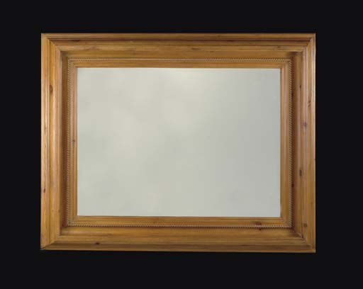 A MOLDED PINE MIRROR,