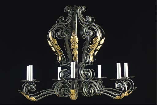 A WROUGHT IRON AND GILT-METAL