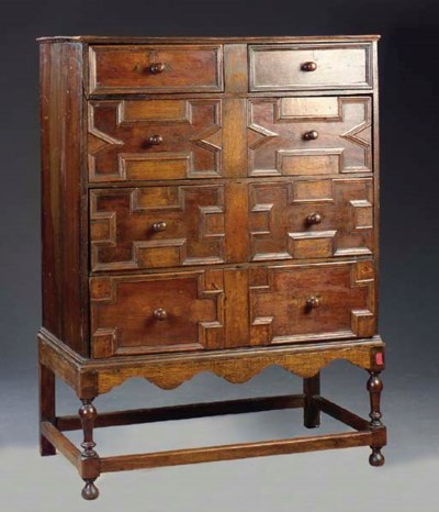 A CHARLES II OAK CHEST ON STAN